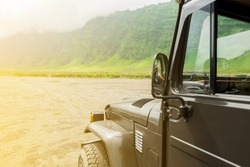 Jeep car on desert road.