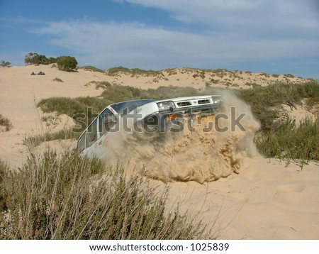 Jeep 4x4 Jumps out of a sand dune