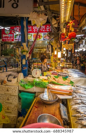 Jeju, South Korea - 29 September 2016: Jeju Dongmun Traditional Market. It has served countless customers in jeju with diverse items at inexpensive prices compared to regular marts or grocery stores. #688345987