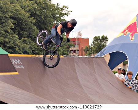 JEKABPILS, LATVIA - JUNE 18: Unidentified young man rides his BMX Bike at the BMX competitions - KUKI MUKI on June 18, 2011 in Skatepark, Jekabpils, Latvia