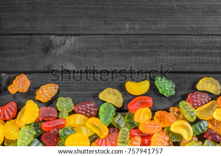jelly and marmalade candies on a wooden background with free space for text. #757941757