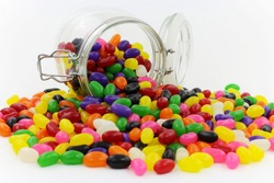 Jelly Beans spilt from Glass Jar with Open Lid and Metal Clasp II