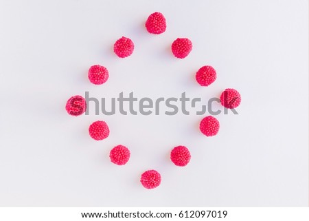 Jelly of red raspberries are in the form of a square or rhombus. A square and a rhombus of pink and red candies and jelly on white background #612097019