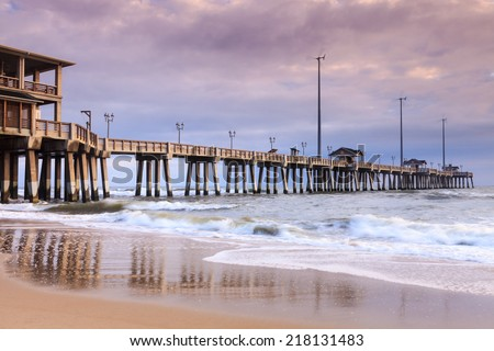 Jennette's fishing pier is an all concrete, 1000 foot long iconic landmark on the shores of the Atlantic Ocean in Nags Head, North Carolina NC. #218131483