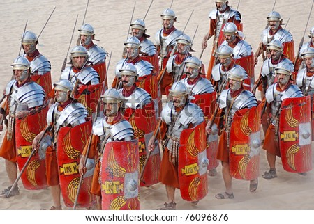 JERASH - NOVEMBER 25: Jordanian men dress as Roman soldier during a roman army reenactment show on November 25, 2009 in Jerash, Jordan - stock photo