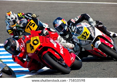 JEREZ DE LA FRONTERA, SPAIN - APR 17: Moto2 motorcyclist Roman Ramos, Jake Gagne and Tomoyoshi Koyama takes a curve in the CEV Championship race on April 17, 2011 in Jerez de la Frontera, Spain.
