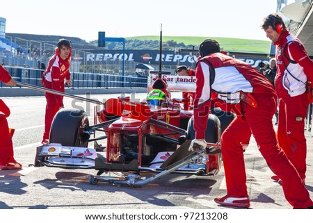 JEREZ DE LA FRONTERA, SPAIN - FEB 08: Felipe Massa of Scuderia Ferrari F1 waiting in pit on training session on February 08 , 2012, in Jerez de la Frontera , Spain