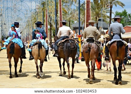 JEREZ DE LA FRONTERA, SPAIN-MAY 12: Riders on horseback walking through the real show horse at the fair the day May 12, 2012 in Jerez de la Frontera, Spain.