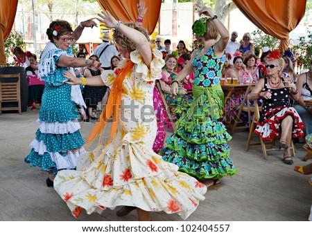 JEREZ DE LA FRONTERA, SPAIN-MAY 12:Women in traditional flamenco dancing during the show the horse the day May 12, 2012, in Jerez de la Frontera, Spain