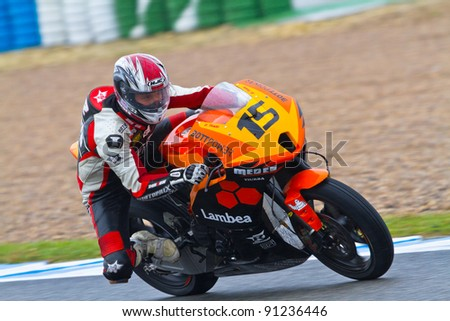 JEREZ DE LA FRONTERA, SPAIN - NOV 20: Moto2 motorcyclist Manuel Tirado takes a curve in the CEV Championship race on November 20, 2011 in Jerez de la Frontera, Spain. - stock photo