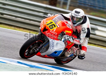 JEREZ DE LA FRONTERA, SPAIN - NOV 19: Moto2 motorcyclist Oscar Climent takes a curve in the CEV Championship race on November 19, 2011 in Jerez de la Frontera, Spain. - stock photo