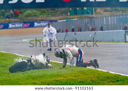 JEREZ DE LA FRONTERA, SPAIN-NOV 20: Stock Extreme motorcyclist Miguel Lopez try to leave the track after an accident in the CEV Championship race on November 20, 2011 in Jerez de la Frontera, Spain