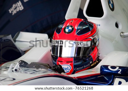 JEREZ DE LA FRONTERA, SPAIN -  OCT 11: Robert Kubica of BMW-Sauber F1 waiting in pit on a training session on October 11 , 2006 in Jerez de la Frontera , Spain