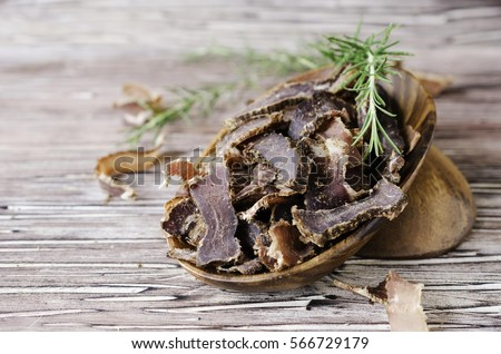 jerked meat, cow, deer, wild beast or biltong in wooden bowls on a rustic table, selective focus Stock photo ©