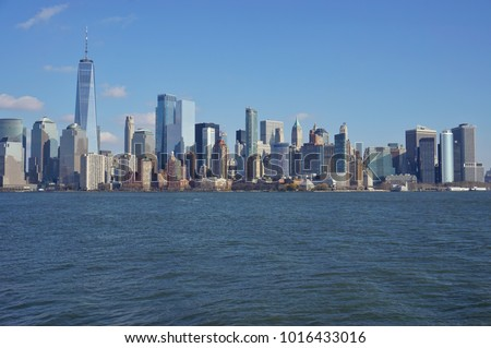 JERSEY CITY, NJ -10 DEC 2017- View of the Manhattan skyline in New York City seen from across the water in Jersey City, New Jersey. #1016433016