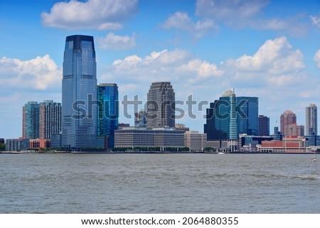 Jersey City - NJ downtown skyline with Hudson river.