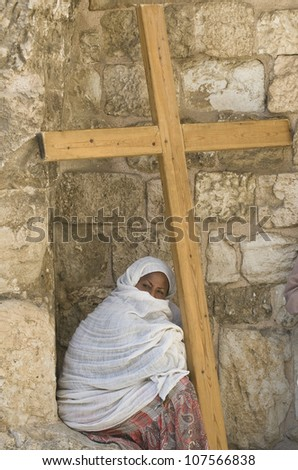 JERUSALEM - APRIL 13 : Ethiopian Christian pilgrim sit with across at the church of the Holy sepulchre in Jerusalem israel during Good Friday on April 13 2012