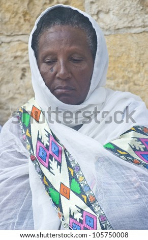 JERUSALEM - APRIL 14 : Ethiopian Orthodox worshiper await the start of the Holy fire ceremony at the Ethiopian section of the Holy Sepulcher in Jerusalm Israel on April 14 2012