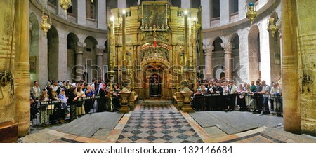 JERUSALEM - APRIL 23: Panorama of Church of the Holy Sepulchre and pilgrims around chapel The Edicule with tomb of Jesus Christ during Easter celebrations in Jerusalem, Israel on April 23, 2006.