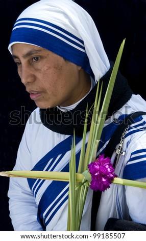 JERUSALEM - APRIL 01 : Unidentified nun take part in the Palm sunday procession in Jerusalem on April 01 2012