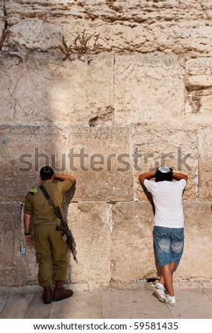 JERUSALEM - AUGUST 15: A member of Israel's military visits Jerusalem's Western Wall on August 15, 2010 in Jerusalem.