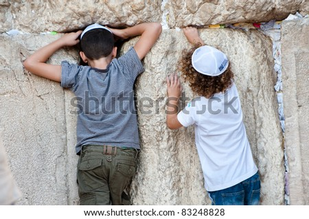 JERUSALEM - AUGUST 21: Jewish boys explore the Western Wall, the holiest site in Judaism, in the Old City of Jerusalem on Aug. 21, 2011.