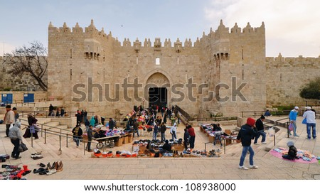 JERUSALEM - FEBRUARY 22: Damascus Gate February 22, 2012 in Jerusalem, IL. The current gate was built in 1537 by Suleiman the Magnificent with repairs to the turrets made in 2011 by Israel.