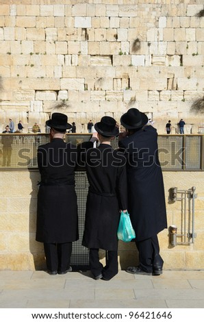 JERUSALEM - FEBRUARY 20: Hasidic Jews at the Kotel (Western Wall) February 20, 2012 in Jerusalem, IL. The kotel is one of the holiest sites in Judaism attracting thousands of worshipers daily.