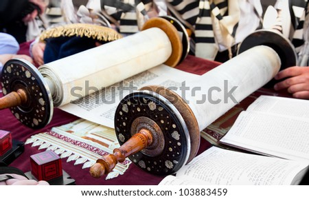 JERUSALEM, ISRAEL - APRIL 26: Jewish reading pray from Torah, ancient scrolls at the western wall on a jewish holiday Israel's 64th Independence Day on April 26, 2012 in Jerusalem, Israel
