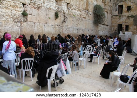 JERUSALEM, ISRAEL - DECEMBER 19: Jewish women pray at the Wailing Wall an important jewish religious site  on December 19, 2012  in Jerusalem, Israel.
