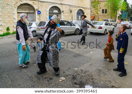 JERUSALEM, ISRAEL - FEBRUARY 25, 2016: Street scene, Breslov Hasidic Jews dance, in the ultra-orthodox neighborhood Mea Shearim, Jerusalem, Israel