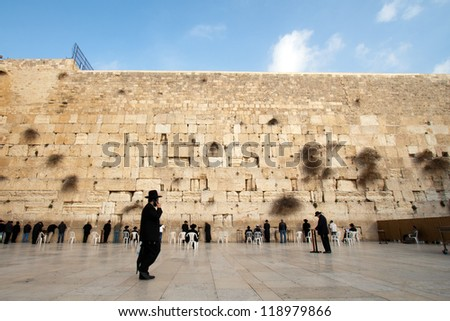 JERUSALEM, ISRAEL - JANUARY 23: Jewish worshipers pray at the Wailing Wall. The most holy site for Jews. January 23, 2011 in Jerusalem, Israel. - stock photo