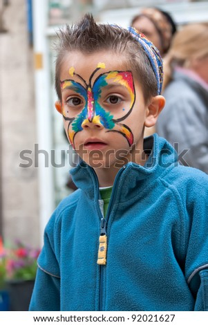 JERUSALEM, ISRAEL - MARCH 15: Purim carnival,Portrait of an unidentified little boy on his face painted butterfly. March 15, 2006 in Jerusalem, Israel. Purim is celebrated annually.