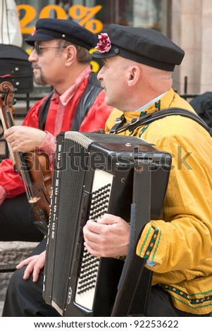 JERUSALEM, ISRAEL - MARCH 15: Purim carnival, unidentified street musicians. March 15, 2006 in Jerusalem, Israel. Purim is celebrated annually according to the Hebrew calendar