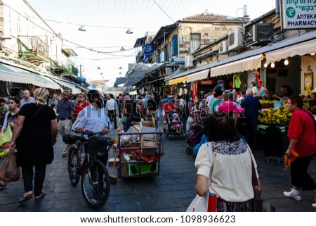 Jerusalem Israel May 24, 2018 Unknowns people walking and shopping at Mahane Yehuda market in Jerusalem afternoon #1098936623