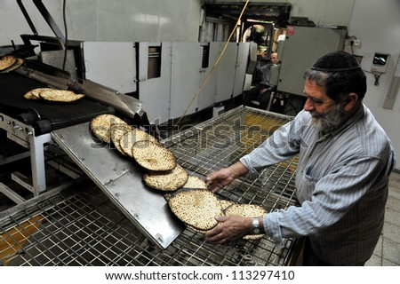 JERUSALEM JERUSALEM - MARCH 16: Orthodox Jewish man prepare hand-made glat kosher matzah for Passover Jewish holiday on March 16 2010 in Jerusalem, Israel.