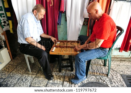 JERUSALEM - JULY 30: old Arab men playing backgammon on July 30 2009 in Jerusalem, Israel.It's one of the oldest board games for two players in the world.