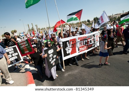 JERUSALEM - JULY 15: Thousands of Israeli, Palestinian, and international activists march  in support of Palestinian rights through East Jerusalem on July 15, 2011.