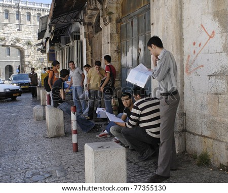 JERUSALEM – JUNE 12: Group of young, male, Arab students stand inside the New Gate on Bab El-Jadid Street in Old City, Jerusalem, Israel, studying for their final graduation exams on June 12, 2007.