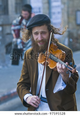 JERUSALEM - MAR. 09 : Ultra Orthodox man during Purim in Mea Shearim Jerusalem on Mar. 09 2012 , Purim is a Jewish holiday celebrates the salvation of the jews from jenocide in ancient Persia