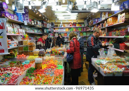 JERUSALEM - MARCH 3: Candy shop in the souq of the Muslim Quarter in the Old City March 3, 2012 in Jerusalem, IL. Souqs are traditional middle eastern markets selling various foods and commodities.