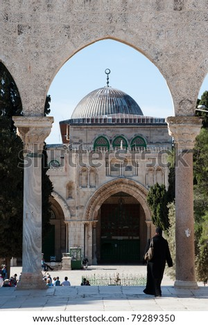 JERUSALEM - MAY 23: A Muslim woman walks near the Al-Aqsa Mosque on the Haram al-Sharif, also known as the Temple Mount, in the Old City of Jerusalem on May 23, 2011.