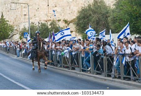 JERUSALEM - MAY 20 : Israeli men march in east Jerusalem  during Jerusalem day on May 20 2012 , Jerusalem day marks the anniversary of the city's reunification in 1967 after 19 years of division