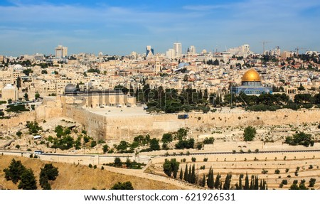 JERUSALEM - May 15 2014: Part of famous Jewish Cemetery dated 3,000 years ago on Mount of Olives with Old Jerusalem on background #621926531