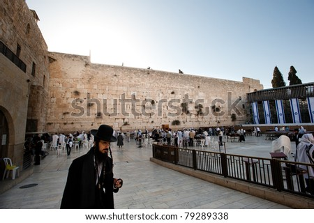 JERUSALEM - MAY 23: The morning sun rises over worshippers at the holiest site in Judaism, the Western Wall, in Jerusalem's Old City on May 23, 2011.