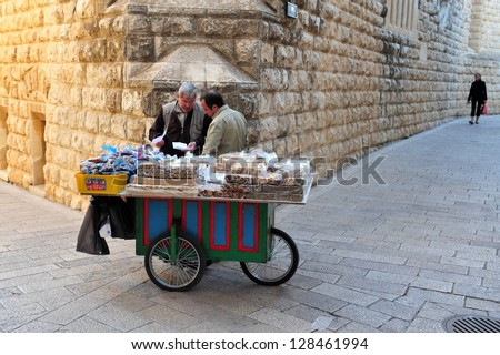 JERUSALEM - NOV 12:Food card of street food in Jerusalem old city. According to a 2007 study from the Food and Agriculture Organization, 2.5 billion people eat street food every day. - stock photo