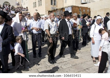 JERUSALEM -OCT 16: Jews in prayer at the Western Wall during Jewish holiday of Sukkot October 16, 2011 in Jerusalem, Israel.