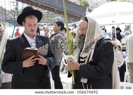JERUSALEM -OCT 16: Jews in prayer at the Western Wall during Jewish holiday of Sukkot October 16, 2011 in Jerusalem, Israel.