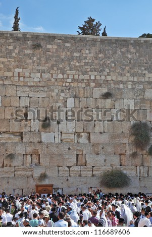 JERUSALEM - OCT 16: The Holy Western Wall of the Temple. Thousands of Jews had gathered for morning prayers on the feast of Sukkot, October 16, 2011 in Jerusalem, Israel