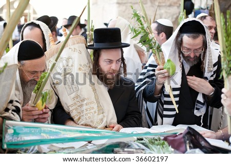 JERUSALEM - OCTOBER 16: Jews in prayer at the Western Wall during Jewish holiday of Sukkot October 16, 2008 in Jerusalem, Israel. Sukkot is one of the Jews three major holidays.